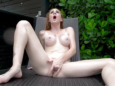 Redhead GInger Babbii masturbates outside using her fingers only