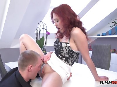 Steamy Redhead Gives A Sucking Cock Give The Office